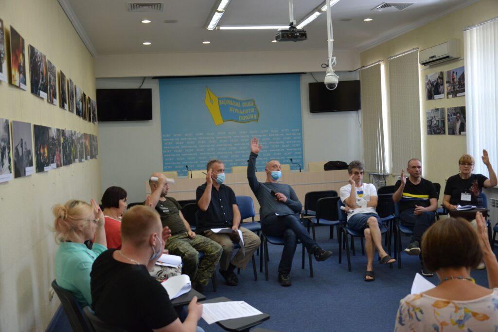 Голосование на заседании рабочей группы